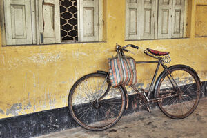 Bicycle leaned against wall