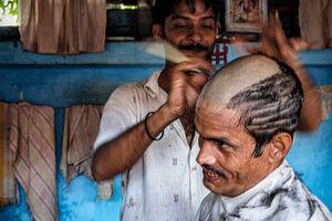 Man taking tonsure