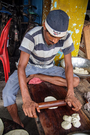 Man working with rolling pin