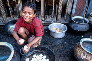 Boy peeling eggshell