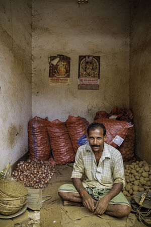 Man selling onion and potato