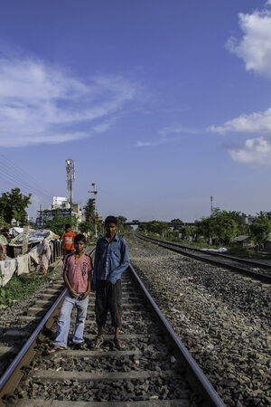 Two boys on railway track