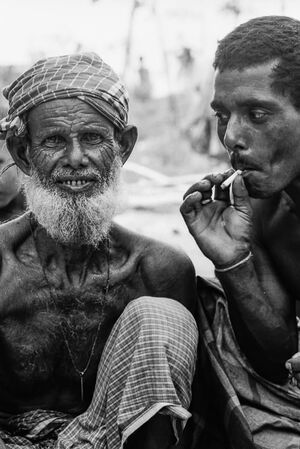 Smiling man and puffing man
