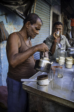 Man pouring Chai