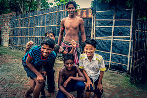 Boys gathering in front of camera