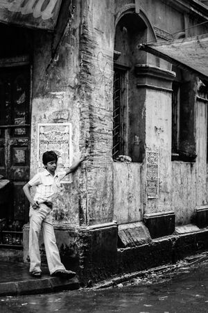 Young man standing in corner of street
