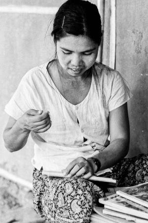 Woman repairing book