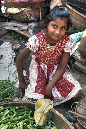 Girl selling Okra