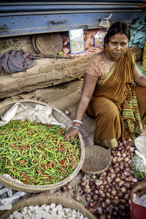 Woman selling chili peppers