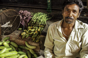 Man selling cucumbers