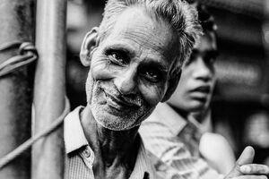 Man smiling in waggish mood