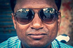 Figure reflected on sunglasses