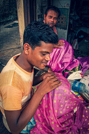 Man doing embrodery