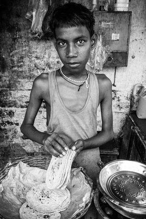 Young man grabbing Roti
