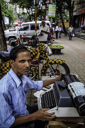 Man working with typewriter