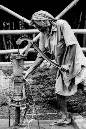 Man collecting water