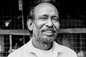 Man smiling gently