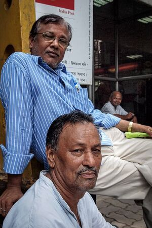 Men at entrance of post office