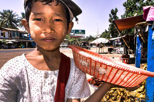 Boy selling eggs