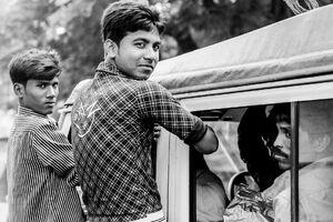 Men holding car