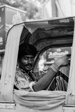 Rickshaw wallah relaxing on seat