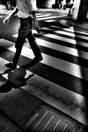 Figure crossing street
