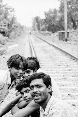 Men relaxing on the railway