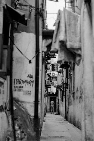 Figure in deserted lane