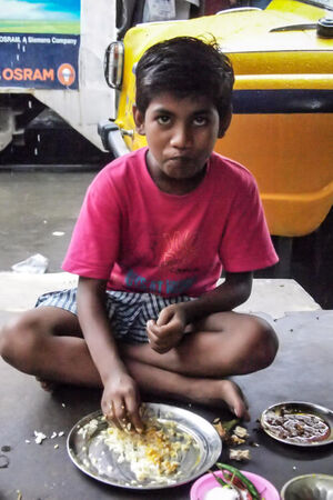 Boy eating curry