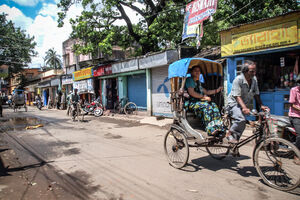 Cycle rickshaw passing