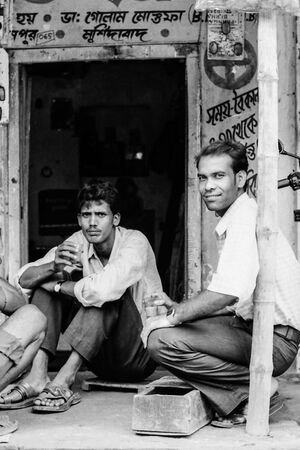 Men drinking a cup of chai