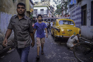 Men walking lane in Kolkata