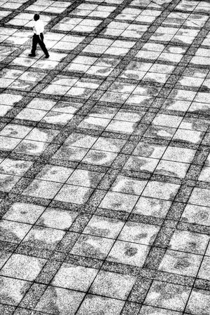 Man walking through pattern