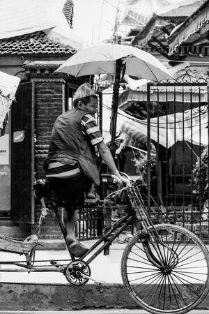 Rickshaw wallah on saddle