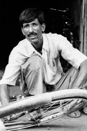Man repairing wheel