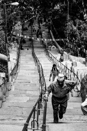Man climbing steep stairway