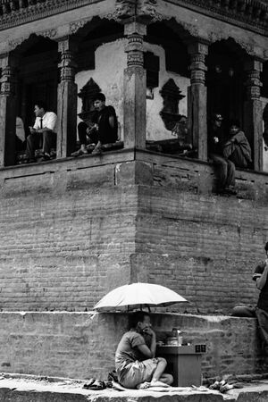 Man working under umbrella