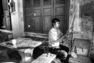 Man repairing fishing net