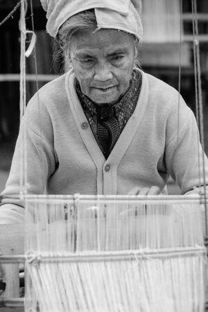 Older woman weaving