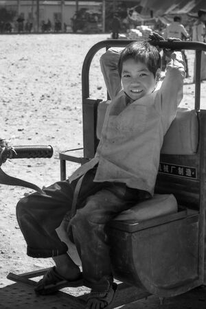 Boy sitting on tractor