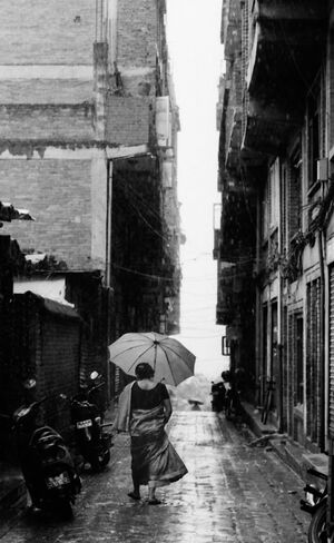 Woman walking in hard rain