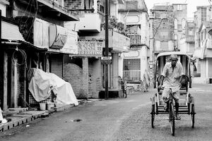 Cycle rickshaw in deserted street