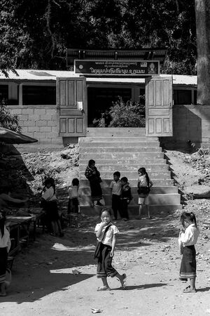 School kids playing in front of gate