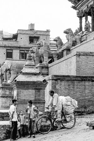 Locals standing talking beside Nyatapola Temple