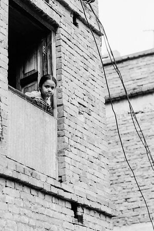 Girl leaning out from window
