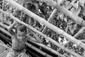 Boy climbing framework