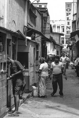 People in narrow street