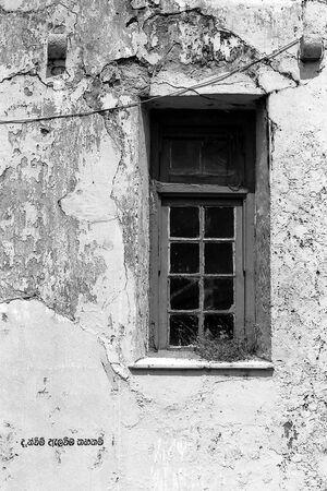 Window on dilapidated wall