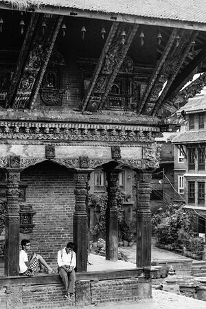 Boys under eaves of temple