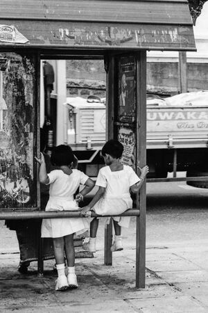 Little girls at bus stop